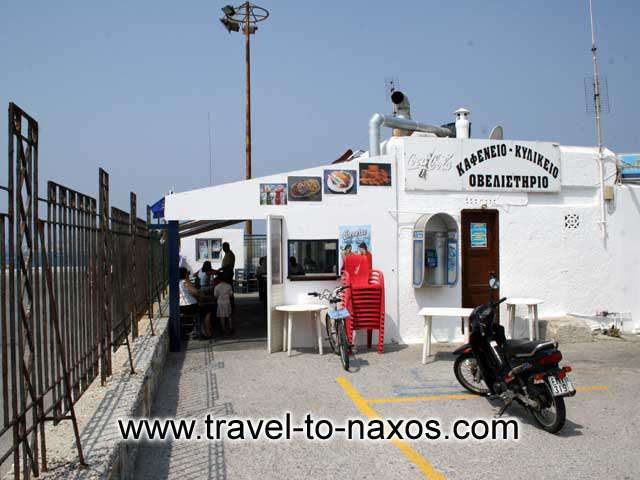 NAXOS PORT - Kafeneio in Greek means coffee shop, however this one will remain in our mind for grilled octapus and souma (the local spirit)